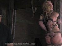 Сжимая сиськи, госпожа раздумывает над поркой булок рабыни